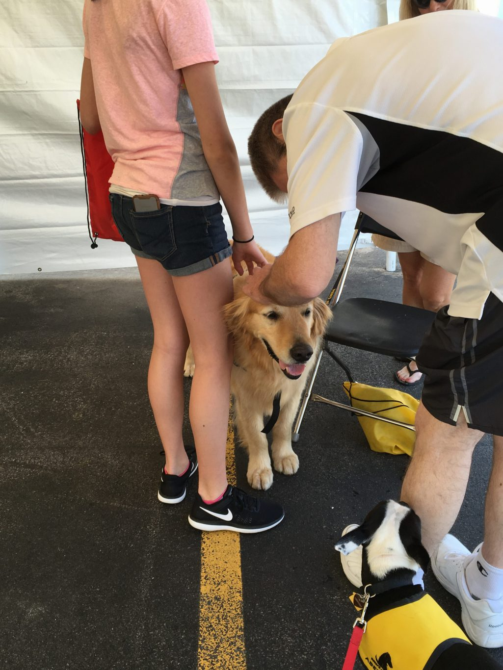 Exelon Nuclear Plant Health and Wellness Fair Therapy Dog and a Man and a Girl